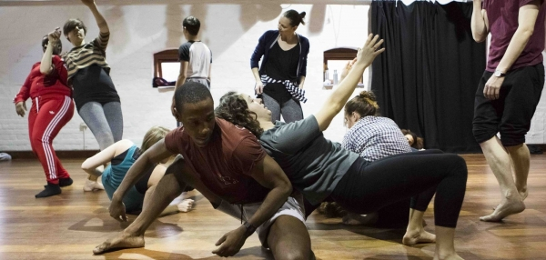 Community dance artists exploring movement in a studio