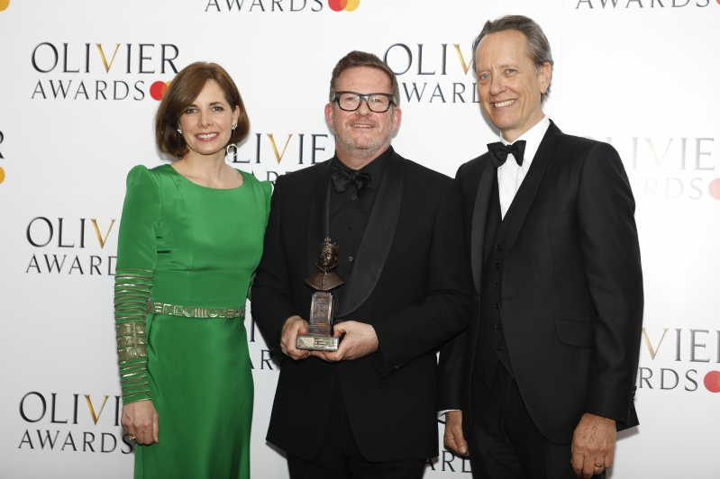 Matthew Bourne with his Special Award in recognition of his achievements in dance at the Oliviers 2019 presented by New Adventures patron Darcey Bussell and actor Richard E. Grant