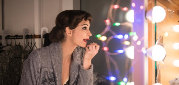 Anjali Mehra doing her make-up backstage for Matthew Bourne's Cinderella