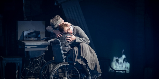 Cinderella (Cordelia Braithwaite) hugging Robert, her father (Alan Vincent) in Matthew Bourne's Cinderella