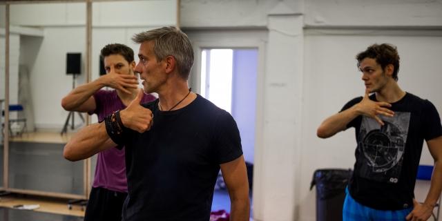 Adam Cooper (Original Swan / Stranger) mentoring the Swans in rehearsals