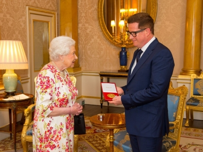 Matthew receiving the Queen Elizabeth II Coronation (QEII) Award from Her Majesty The Queen